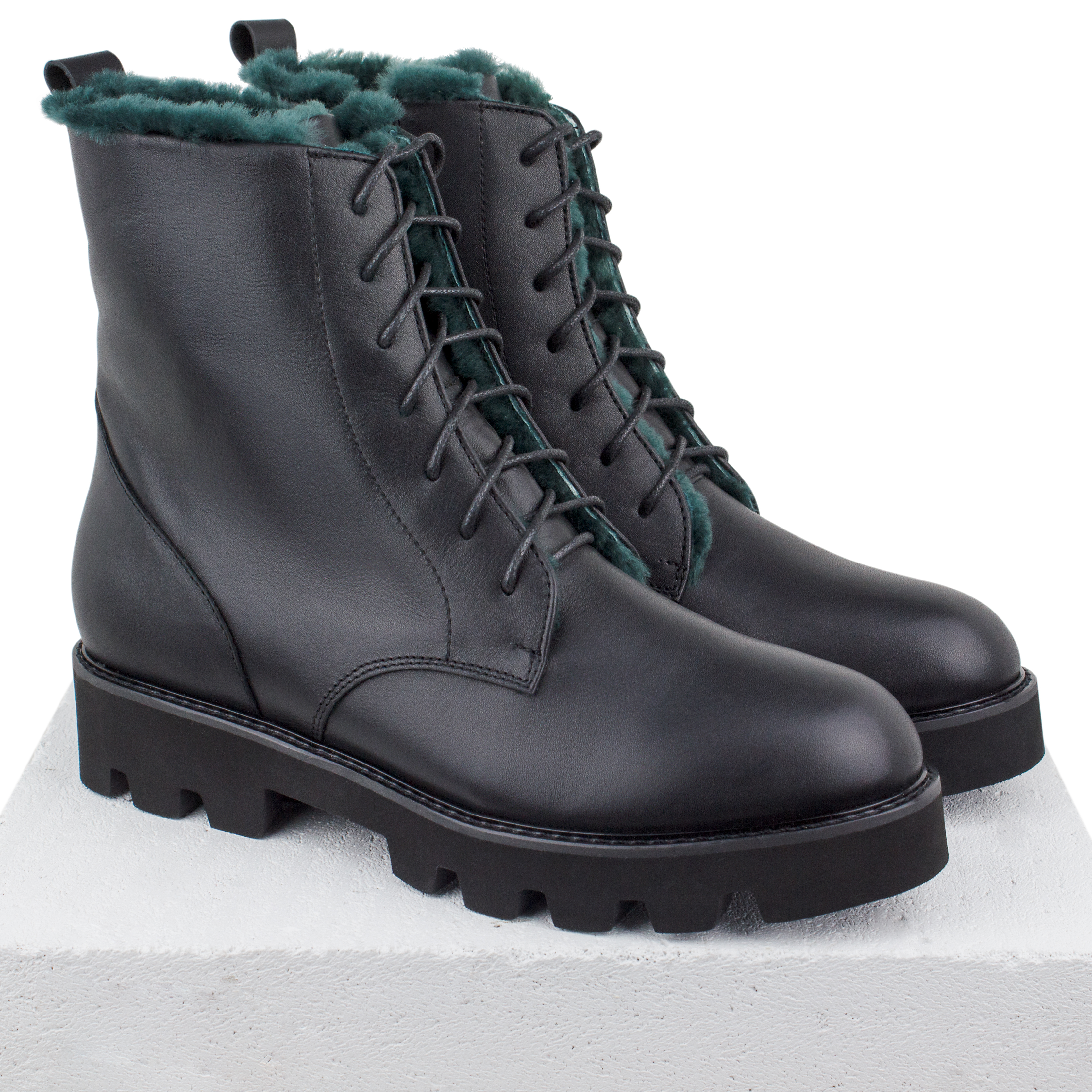Women's high boots made of genuine leather Lapti black on green fur