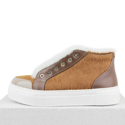 Women's slip-on made of genuine leather Lapti beige on fur with a pony print